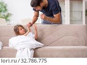 Купить «Father taking care of his ill daughter», фото № 32786775, снято 6 августа 2019 г. (c) Elnur / Фотобанк Лори