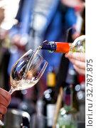 Купить «White wine is poured into a glass. Festive party», фото № 32787875, снято 21 декабря 2019 г. (c) Евгений Ткачёв / Фотобанк Лори