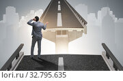 Купить «Young businessman in uncertainty concept with bridge», фото № 32795635, снято 28 января 2020 г. (c) Elnur / Фотобанк Лори