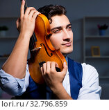 Купить «Young musician man practicing playing violin at home», фото № 32796859, снято 15 августа 2017 г. (c) Elnur / Фотобанк Лори