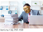 Купить «Businessman wearing mask in hypocrisy concept», фото № 32797159, снято 24 июня 2019 г. (c) Elnur / Фотобанк Лори