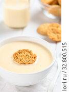 Купить «Homemade traditional Danish cold buttermilk koldskal dessert soup with crisp kammerjunkere cookie on top (Selective Focus, Focus on the front of the cookie)», фото № 32800515, снято 5 апреля 2020 г. (c) easy Fotostock / Фотобанк Лори