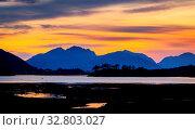 Sun setting over Loch Leven, Scotland. Стоковое фото, фотограф Zoonar.com/christopher smith / easy Fotostock / Фотобанк Лори