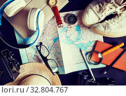 Купить «Overhead view of travel accessories and vacation items. Outfit of traveler. Vintage toned image. Top view. Flat lay.», фото № 32804767, снято 19 февраля 2020 г. (c) easy Fotostock / Фотобанк Лори