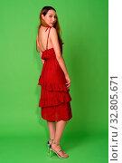 Купить «Studio shot of young beautiful Asian woman against green background», фото № 32805671, снято 27 мая 2020 г. (c) easy Fotostock / Фотобанк Лори