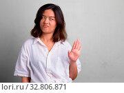 Купить «Studio shot of young beautiful Asian woman with short hair against white background», фото № 32806871, снято 27 мая 2020 г. (c) easy Fotostock / Фотобанк Лори