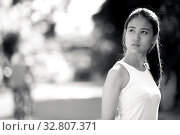 Купить «Portrait of young beautiful Asian businesswoman in the streets outdoors in black and white», фото № 32807371, снято 27 мая 2020 г. (c) easy Fotostock / Фотобанк Лори