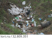 Купить «Elemental dump plastic garbage on the roadside near the outskirts of the forest. Pollution of the environment with plastic and other wastes. Plastic debris on the grass among trees. Environmental plastic pollution is ecological problem.», фото № 32809351, снято 13 декабря 2019 г. (c) Некрасов Андрей / Фотобанк Лори