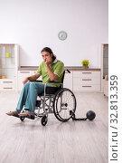 Купить «Young male invalid in wheel-chair suffering at home», фото № 32813359, снято 23 июля 2019 г. (c) Elnur / Фотобанк Лори