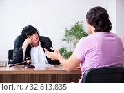Купить «Young man consulting with judge on litigation issue», фото № 32813835, снято 6 мая 2019 г. (c) Elnur / Фотобанк Лори