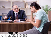 Купить «Young man visiting experienced male lawyer», фото № 32813883, снято 23 апреля 2019 г. (c) Elnur / Фотобанк Лори