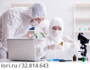Купить «Two chemists working in the lab», фото № 32814643, снято 14 ноября 2017 г. (c) Elnur / Фотобанк Лори