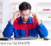 Купить «Repairman working in technical support fixing computer laptop tr», фото № 32814975, снято 27 июля 2017 г. (c) Elnur / Фотобанк Лори
