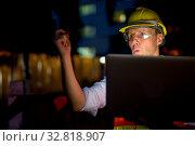 Купить «Portrait of mature man construction worker at the construction site in the city at night», фото № 32818907, снято 4 апреля 2020 г. (c) easy Fotostock / Фотобанк Лори