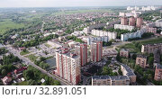 Купить «Aerial view of modern residential areas of Chekhov city in sunny spring day, Russia», видеоролик № 32891051, снято 13 мая 2019 г. (c) Яков Филимонов / Фотобанк Лори
