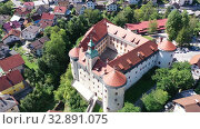 Aerial view of impressive medieval Gewerkenegg Castle in small Slovenian township of Idrija on sunny autumn day (2019 год). Стоковое видео, видеограф Яков Филимонов / Фотобанк Лори