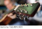 Купить «Image of modern acoustic guitar in music store.», фото № 32891931, снято 18 сентября 2017 г. (c) Яков Филимонов / Фотобанк Лори