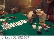 Купить «Poker player with gun plays in casino, risk», фото № 32892607, снято 8 декабря 2019 г. (c) Tryapitsyn Sergiy / Фотобанк Лори