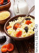 Купить «Millet porridge with dried fruits», фото № 32892743, снято 26 марта 2019 г. (c) Надежда Мишкова / Фотобанк Лори