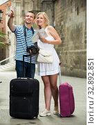 Купить «Couple searching direction using map», фото № 32892851, снято 31 марта 2020 г. (c) Яков Филимонов / Фотобанк Лори