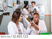 Купить «Girl and guy checking telephone set in escape room», фото № 32893123, снято 8 октября 2018 г. (c) Яков Филимонов / Фотобанк Лори