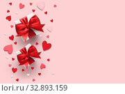 Купить «Valentine's day gifts with red bows and hearts», фото № 32893159, снято 29 ноября 2019 г. (c) Евдокимов Максим / Фотобанк Лори