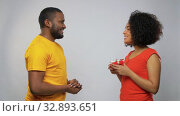happy african american couple with red gift box. Стоковое видео, видеограф Syda Productions / Фотобанк Лори