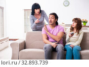 Купить «Young family and mother-in-law in family issues concept», фото № 32893739, снято 26 апреля 2019 г. (c) Elnur / Фотобанк Лори