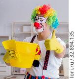 Купить «Funny clown doing cleaning at home», фото № 32894135, снято 12 мая 2017 г. (c) Elnur / Фотобанк Лори