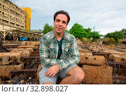 Купить «Portrait of handsome Persian tourist man at the railway station in Bangkok, Thailand», фото № 32898027, снято 7 июля 2020 г. (c) easy Fotostock / Фотобанк Лори