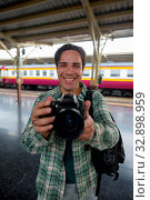 Купить «Portrait of handsome Persian tourist man at the railway station in Bangkok, Thailand», фото № 32898959, снято 7 июля 2020 г. (c) easy Fotostock / Фотобанк Лори