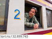 Купить «Portrait of handsome Persian tourist man at the railway station in Bangkok, Thailand», фото № 32899743, снято 7 июля 2020 г. (c) easy Fotostock / Фотобанк Лори
