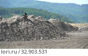 Купить «Heaps of ash and slag waste at ash and slag dump of thermal power. Problem of environmental pollution. Climate change from burning of hydrocarbon fuels», видеоролик № 32903531, снято 8 сентября 2018 г. (c) Dmitry Domashenko / Фотобанк Лори