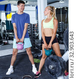 Купить «Couple during weightlifting workout», фото № 32903643, снято 16 июля 2018 г. (c) Яков Филимонов / Фотобанк Лори