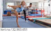 Man and woman doing exercises on floor. Стоковое фото, фотограф Яков Филимонов / Фотобанк Лори