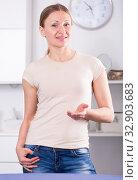 Купить «Positive woman standing at room», фото № 32903683, снято 12 апреля 2017 г. (c) Яков Филимонов / Фотобанк Лори