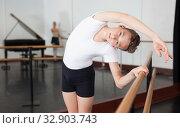 Купить «Young efficient dancer exercising in ballroom», фото № 32903743, снято 26 апреля 2019 г. (c) Яков Филимонов / Фотобанк Лори