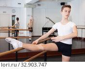 Купить «Young efficient dancer exercising in ballroom», фото № 32903747, снято 26 апреля 2019 г. (c) Яков Филимонов / Фотобанк Лори