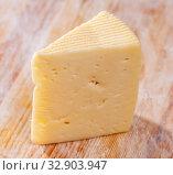 Купить «Piece of fresh semi-soft cheese», фото № 32903947, снято 27 февраля 2020 г. (c) Яков Филимонов / Фотобанк Лори