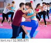 Купить «Women doing kick with coach», фото № 32905871, снято 8 октября 2017 г. (c) Яков Филимонов / Фотобанк Лори