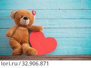 Купить «Teddy bear with red heart on old wooden background. Valentine's day concept», фото № 32906871, снято 14 декабря 2019 г. (c) Майя Крученкова / Фотобанк Лори