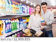 Купить «Happy couple buying household chemicals», фото № 32909855, снято 7 ноября 2019 г. (c) Яков Филимонов / Фотобанк Лори