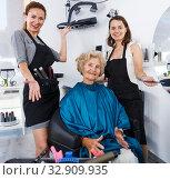 Купить «Hairstylists and satisfied female customer after haircut», фото № 32909935, снято 26 июня 2018 г. (c) Яков Филимонов / Фотобанк Лори
