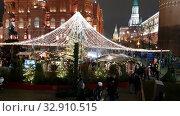 Купить «Moscow, Russia - 21 Dec 2019. Christmas decoration on Manezhnaya Square. Journey to Christmas is Moscow Seasons - winter festival», видеоролик № 32910515, снято 21 декабря 2019 г. (c) Володина Ольга / Фотобанк Лори