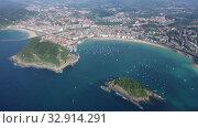 Купить «Aerial panoramic view of summer seascape with La Concha Bay and coastal city of San Sebastian, Basque Country, Spain», видеоролик № 32914291, снято 16 июля 2019 г. (c) Яков Филимонов / Фотобанк Лори