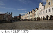 Купить «Picturesque architecture of ancient houses on main square of small Czech town of Telc on sunny autumn day», видеоролик № 32914575, снято 12 октября 2019 г. (c) Яков Филимонов / Фотобанк Лори