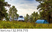 Купить «Russia, Samara, September 2019: Mitsubishi crossover and blue tent stand in a pine forest.», фото № 32919715, снято 15 сентября 2019 г. (c) Акиньшин Владимир / Фотобанк Лори