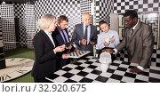 Businesspeople solving conundrum together. Стоковое фото, фотограф Яков Филимонов / Фотобанк Лори