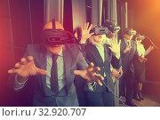 Купить «Happy man wearing VR glasses», фото № 32920707, снято 29 января 2019 г. (c) Яков Филимонов / Фотобанк Лори