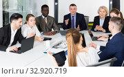 Купить «Business people discussing strategy for teamwork», фото № 32920719, снято 10 марта 2018 г. (c) Яков Филимонов / Фотобанк Лори
